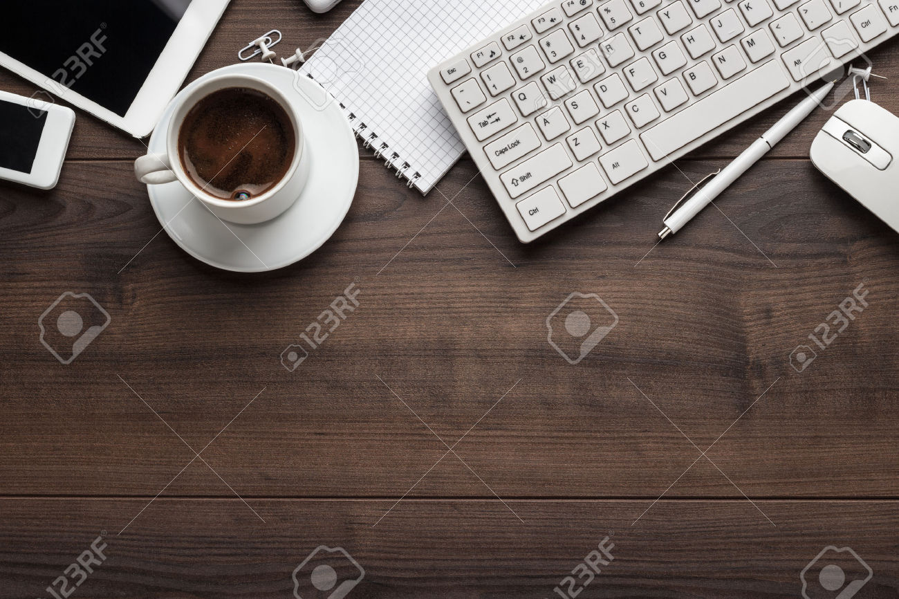 45551682-office-table-with-notebook-computer-keyboard-mouse-cup-of--Stock-Photo